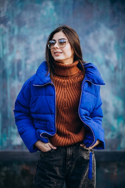 Young attractive woman in blue winter jacket Free Photo