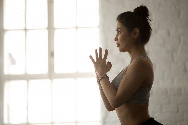 Young attractive woman making namaste gesture Free Photo