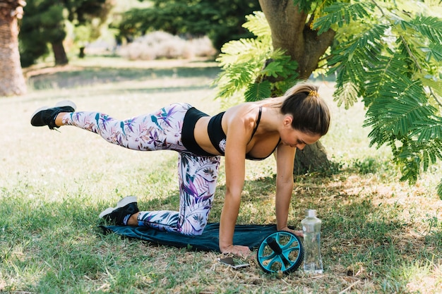 Young attractive woman practicing yoga in the garden Free Photo