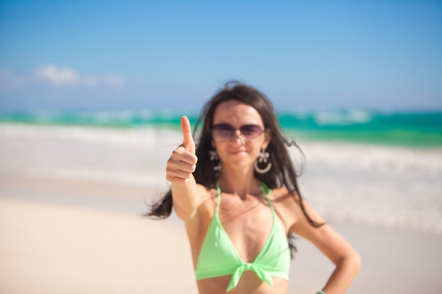 Young attractive woman shows ok in the camera Premium Photo