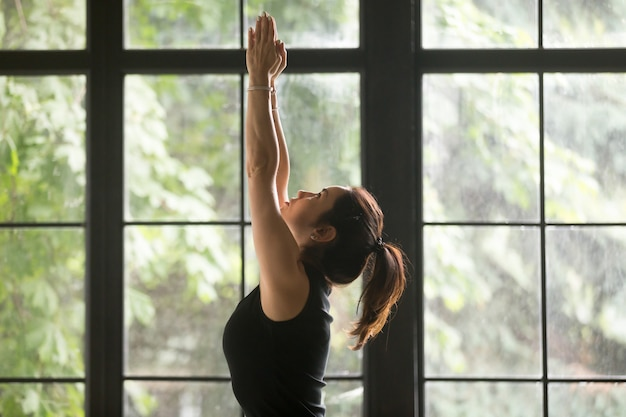 Young attractive woman in tadasana pose, window background Free Photo
