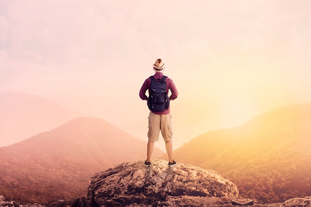 Young backpacker enjoying a valley view Premium Photo