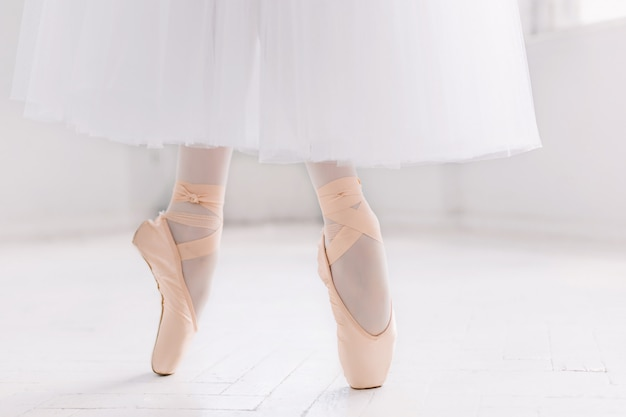 Young ballerina, closeup on legs and shoes Free Photo