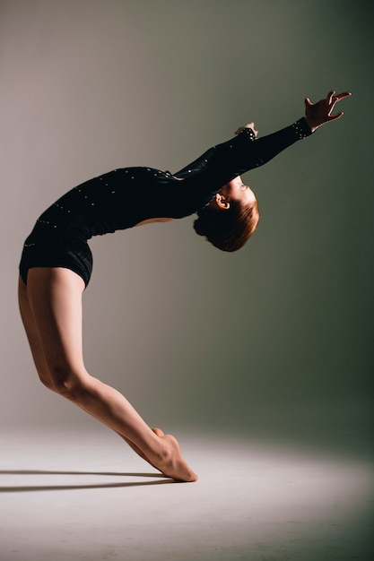 Young ballerina having exercises in the studio Premium Photo