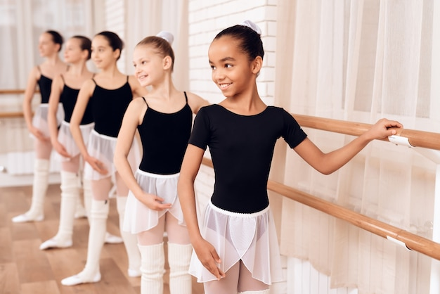 Young ballerinas rehearsing in the ballet class. Premium Photo