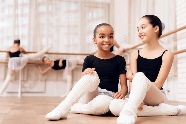Young ballerinas rest during a break in the ballet classes. Premium Photo