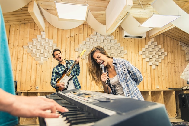 Young band music recording in a studio. Premium Photo