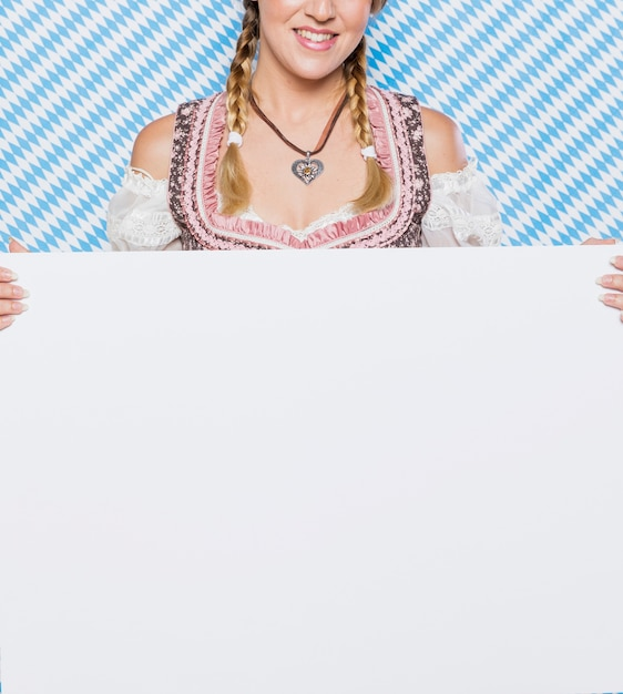 Young bavarian girl in traditional costume Free Photo