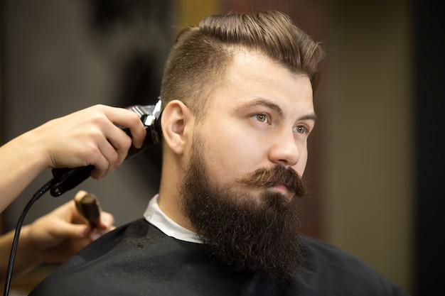 young bearded man in hairdresser salon photo free download