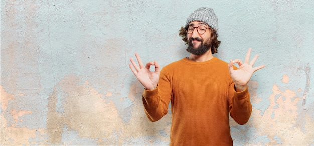 Young bearded man okay or alright pose Premium Photo