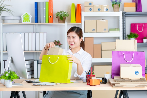 Young and beautiful asian woman with smiling face in office Premium Photo