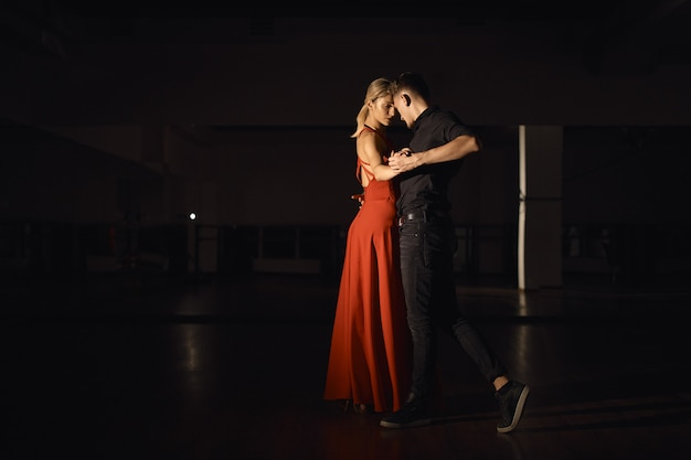 Young beautiful couple dancing with passion Free Photo