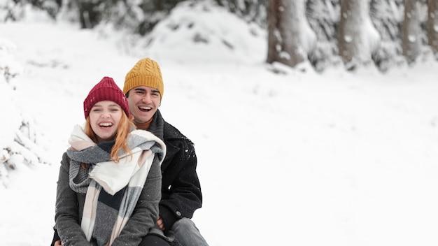 Young beautiful couple having fun in the snow Free Photo