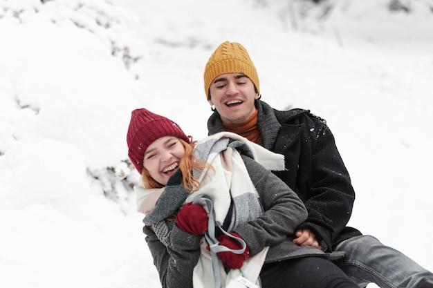 Young beautiful couple having fun in winter Free Photo