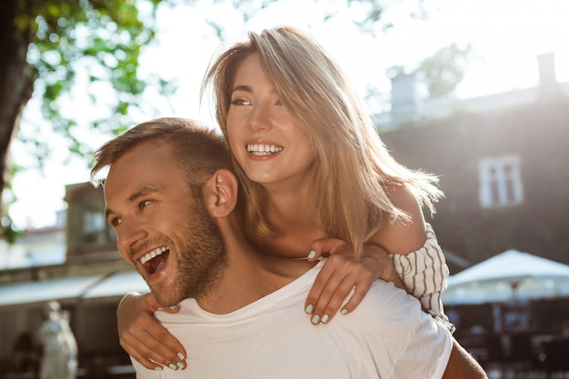 Young beautiful couple smiling, embracing, walking in park. Free Photo