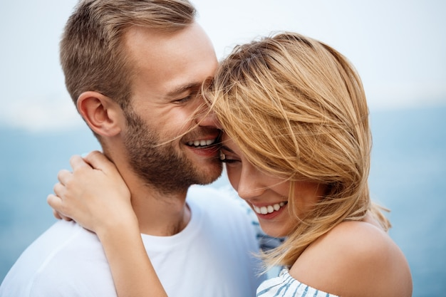 Young beautiful couple smiling, rejoicing, sea views. Free Photo