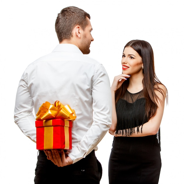 Young beautiful couple with present on white Premium Photo