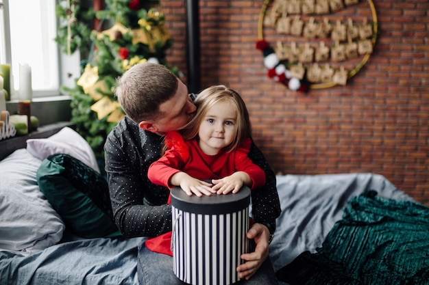 Young beautiful father and mother with baby Free Photo