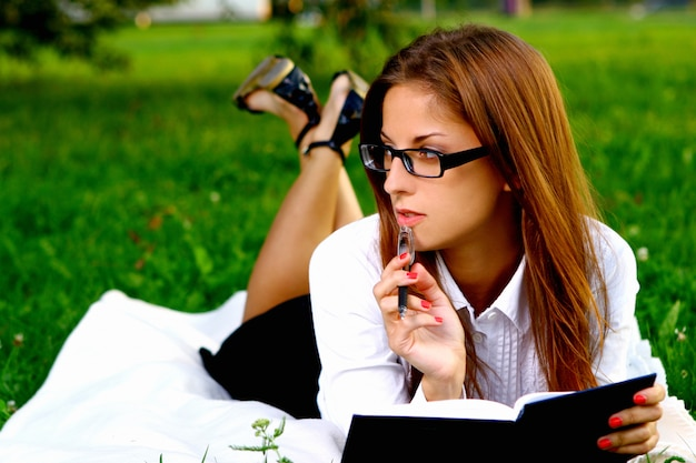 Young and beautiful girl doing home work Free Photo
