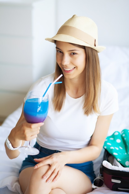 Young beautiful girl drinking a cocktail Premium Photo