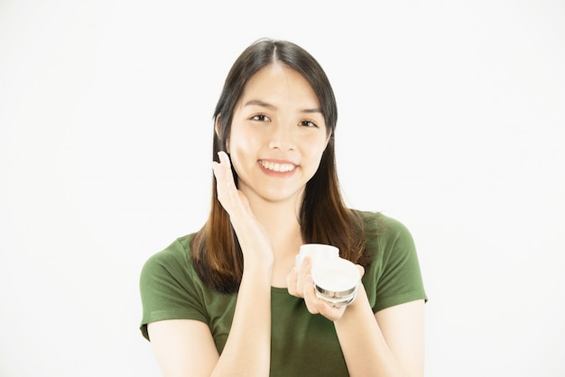Young beautiful lady using moisturizer cream for face skin care - woman and cosmetic makeup face beauty skin care concept Free Photo