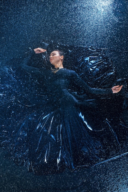 The young beautiful modern dancer dancing under water drops Free Photo