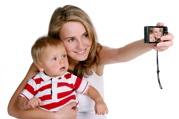 A young and beautiful mother with kid Free Photo