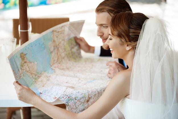 2020 young-beautiful-newlyweds-smiling-choosing-honeymoon-trip-looking-map_176420-2270.jpg