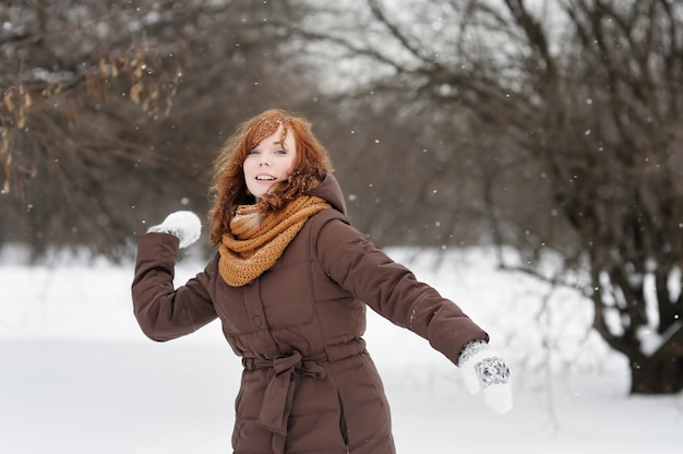 Young beautiful red haired woman having fun in winter Premium Photo