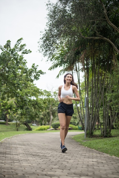 Young beautiful sport woman running at the park. health and sport concept. Free Photo