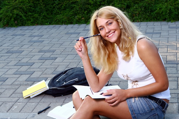 Young and beautiful student girl Free Photo