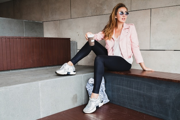 Young beautiful stylish hipster woman in pink leather jacket Free Photo