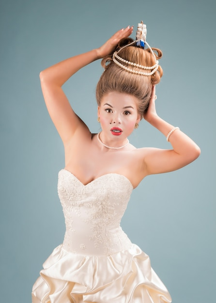 Young beautiful surprised woman in vintage victorian dress with complicated hairstyle Premium Photo