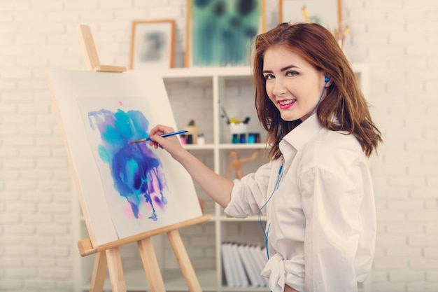 Young Beautiful Woman Artist Drawing Abstract Painting On An