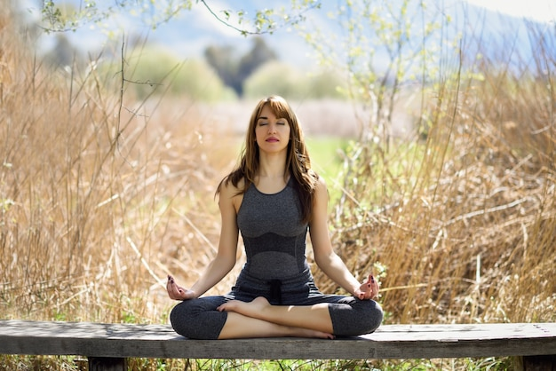 Young beautiful woman doing yoga in nature Free Photo
