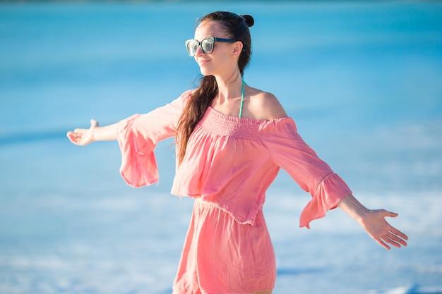 Young beautiful woman having fun on tropical seashore. Premium Photo