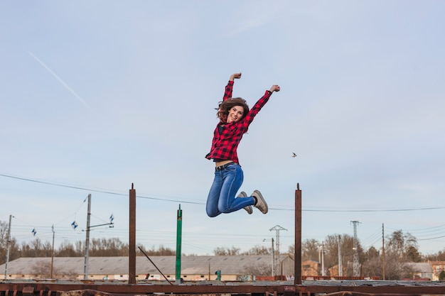 Young beautiful woman jumping and feeling Premium Photo
