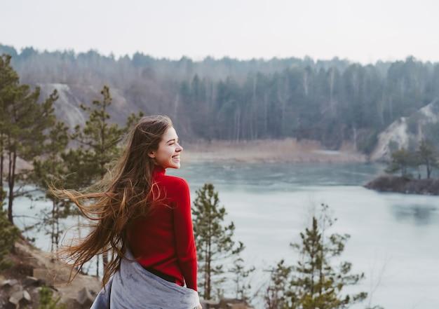 Young beautiful woman posing on a lake Free Photo