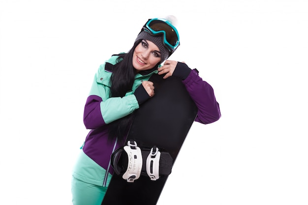 Young beautiful woman in purple ski suit hold snowboard Premium Photo