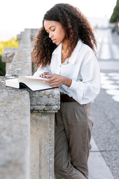 Young beautiful woman reading a book Free Photo