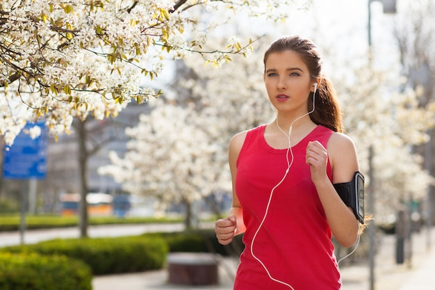 Young beautiful woman running in the city Premium Photo