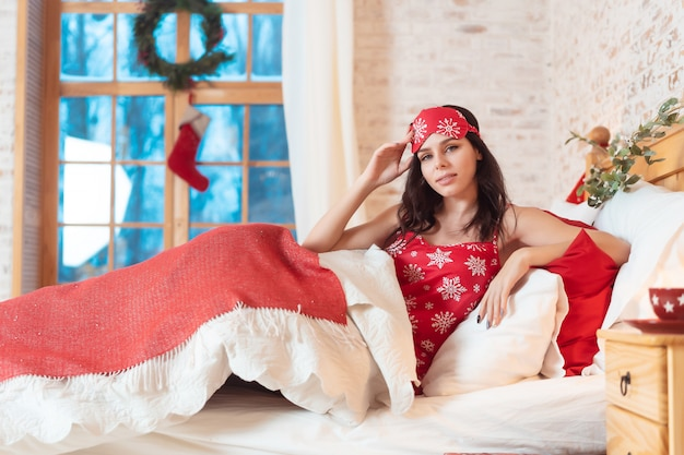 Young beautiful woman sleeping in her bed Free Photo