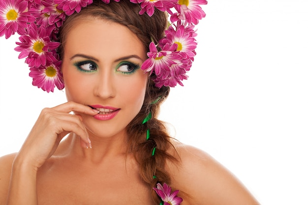 Young beautiful woman with flowers in hair Free Photo