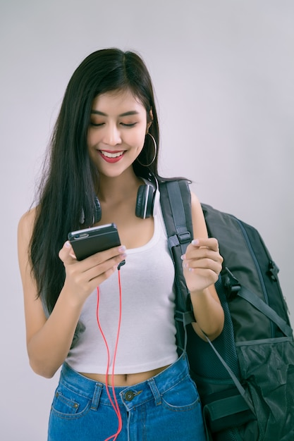 Young beautiful woman with smartphone Free Photo