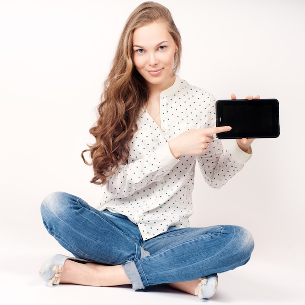 Young beauty student girl with tablet Premium Photo