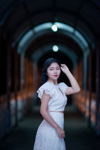 Young beauty woman in white dress of night light Free Photo