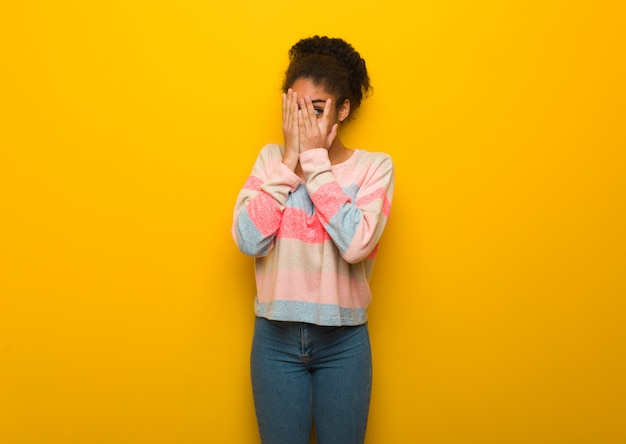 Young black african american girl with blue eyes feels worried and scared Premium Photo