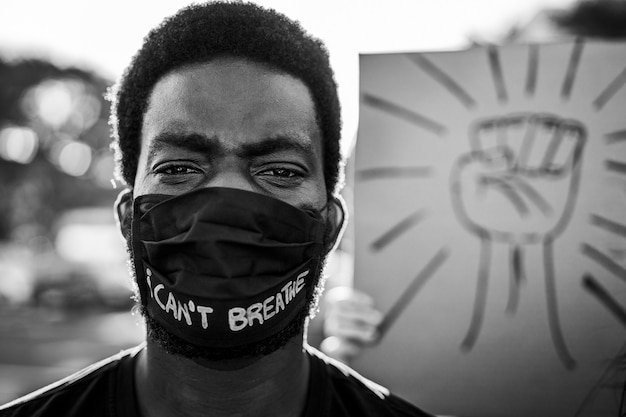 Young black man wearing face mask during equal rights protest Premium Photo