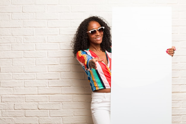 Young Black Woman Reaching Out To Greet Someone Or Gesturing To Help