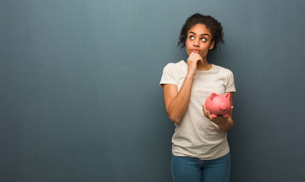 Young black woman thinking about an idea Premium Photo